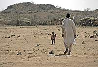 Sudan: Nomad and his son: A nomad and his son in Darfur, Sudan, live in what is already a marginal climate. Even small shifts in rainfall and temperature can make this land unihabitable.   UN Photo/Stuart Price