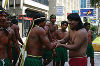 Hiparidi Top'tiro shakes hands with Krahó men who won a log race that was part of a meeting of Indigenous leaders in São Paulo in 2004. Their meeting helped to lay the ground work for the founding of MOPIC in 2007. Photo courtesy of Sylvia Caiuby Novaes.