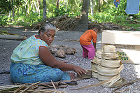 Teramira wraps dried pandanus leaves into large rolls. I-Kiribati women use these leaves to weave a variety of household products, such as mats, curtains, and traditional clothing.