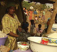 This woman in a marketplace is selling soumbala along with other traditional foods. Photo by Christian Costeaux.