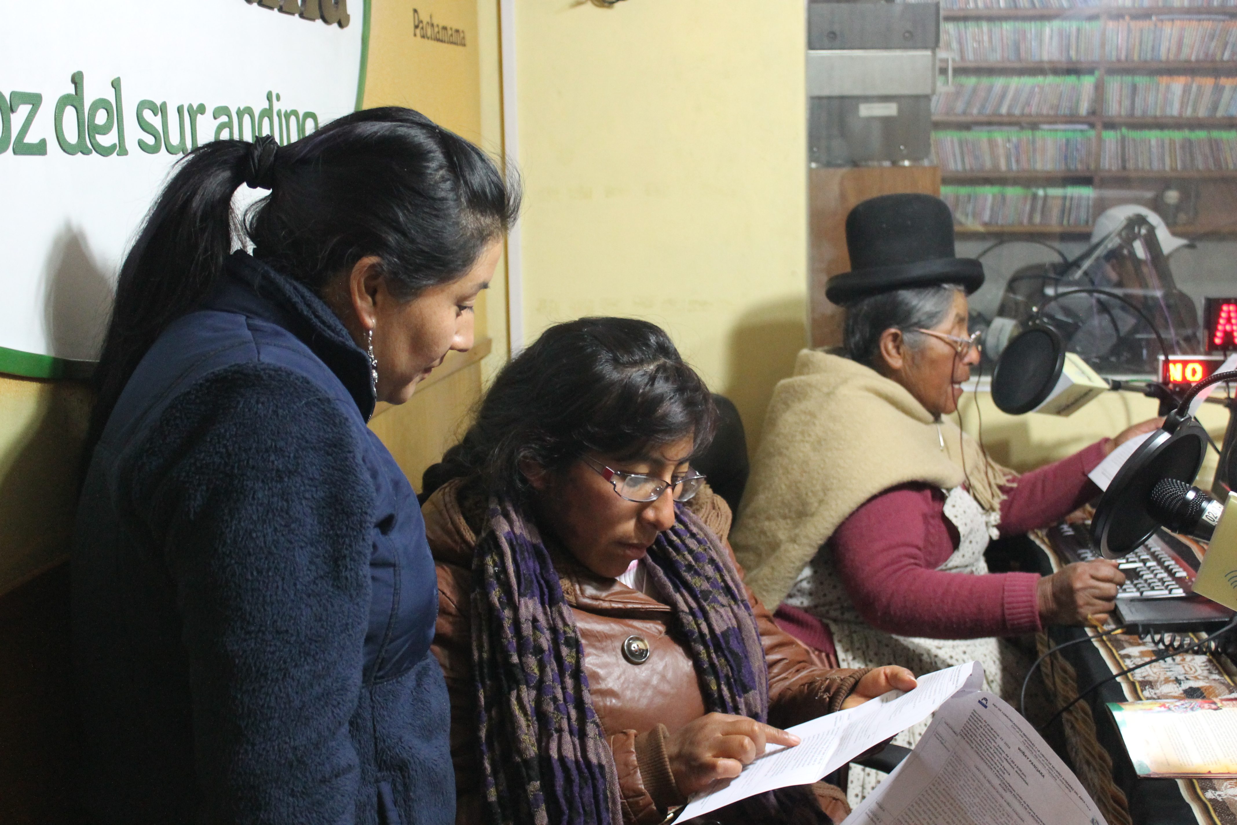 Women of UMA on air at Radio Pachamama in Puno, Peru.