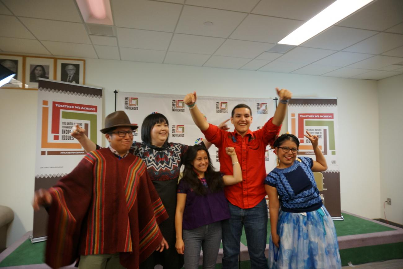Members of the Global Indigenous Youth Caucus in a celebratory moment.